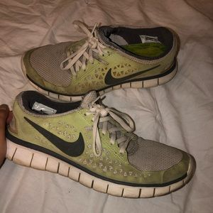 Nike free runs running shoes